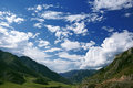 Altai mountain under blue sky with clouds Royalty Free Stock Images