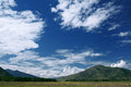 Altai mountain under blue sky with clouds Royalty Free Stock Image
