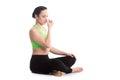 Alternate nostril breathing in yoga sukhasana pose calm beautiful girl practicing hatha nadi shodhana pranayama sitting cross Stock Images