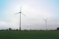 Alternative energy wind turbines in the country side Stock Photos