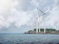 Alternative energy wind turbines on water are creating a shore for a clean environment concept Stock Images