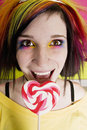 Alternative Girl with a Heart Lollipop Royalty Free Stock Images