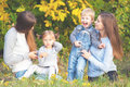 Alternative lesbian family with mothers, daughter and boy outdoor Royalty Free Stock Photo