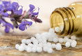 Alternative medicine with homeopathic pills Royalty Free Stock Photo