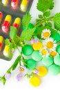 Alternative medicine. Pills and herbs Stock Photos