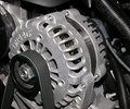 Alternator on an automobile. Royalty Free Stock Photo