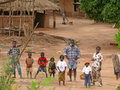 Alto molocue mozambique december most african family the village his parents and six children standing outside his home in Stock Photo