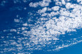 Altocumulus clouds in blue sky on sunny peaceful day Royalty Free Stock Photo