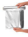 Aluminum foil woman holding a roll of Stock Images