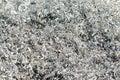 Aluminum shavings a pile of awaits at a metal recycling yard Stock Image