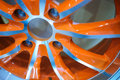 Aluminum wheel an orange a alloy hub and spokes Stock Photo