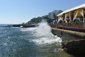 ALUSHTA, CRIMEA, RUSSIA - SEPTEMBER 19.2015: Foam wave is incident on the plate of the embankment.