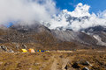 Ama dablam mountain base camp expedition mountaineers tents alpinists snow peak glacier everest trekking route Stock Image