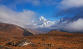 Ama dablam peak m among the clouds at sunrise nepal himalayas Royalty Free Stock Image