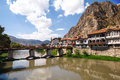 Amasya houses next to the yesilirmak river and stone tombs of kings in turkey Stock Photo