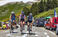 Amateur cyclists in pyrenees mountains port de pailheres france july group of three helping each other while climbing the Royalty Free Stock Photography