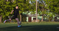 Amateur football player young kicking the ball from the air Royalty Free Stock Photos