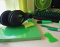 Amateur green. A computer, headphone, pens, marker on wood table Royalty Free Stock Photo