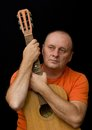Amateur guitarist portrait of mature man Stock Photography