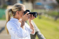 Amateur middle aged photographer taking pictures outdoors Royalty Free Stock Photo