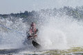 Amateur skier falling and splashing lots of water Stock Images