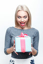 Amazed blond haired woman getting present what surprised young big with great amazement on white isolated background Stock Photos