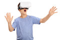 Amazed boy looking in a vr goggles little and gesturing with his hands isolated on white background Stock Photos