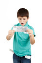 Amazed boy looks at the bill from czech crown banknotes Royalty Free Stock Images