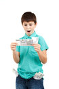 Amazed boy looks at the bill from czech crown banknotes Stock Photography