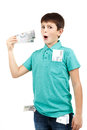 Amazed boy looks at the bill from czech crown banknotes Royalty Free Stock Image
