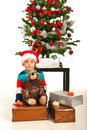 Amazed boy with xmas presents little christmas in front of tree Royalty Free Stock Photos