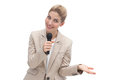 Amazed businesswoman speaking on microphone at public presentation Royalty Free Stock Image