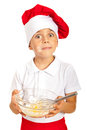 Amazed chef boy holding dough with messy face of flour isolated on white background Stock Images