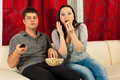 Amazed couple watching tv Royalty Free Stock Photo