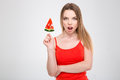 Amazed excited young female holding watermelon shaped lollypop Royalty Free Stock Photo