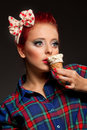 Amazed girl bright picture of pretty in checked shirt with ice cream in studio Royalty Free Stock Photography