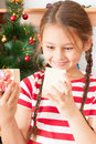 Amazed girl with gift cute new year Stock Photo