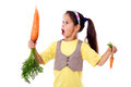 Amazed girl with two carrots stands different sized isolated on white Royalty Free Stock Photos