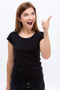 Amazed happy young woman pointing away over white background Royalty Free Stock Photography