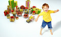 Amazed little boy with lots of presents Stock Image