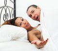 Amazed lovers in bed Royalty Free Stock Photography