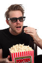Amazed man in 3D-glasses with a popcorn bucket Royalty Free Stock Image