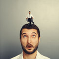 Amazed man with happy successful man portrait of on the head Stock Image