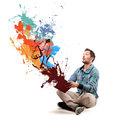 Amazed man opening a book and coming out colourful paint Royalty Free Stock Photo