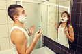Amazed man shaving men and looking in the mirror Stock Images