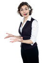 Amazed pretty young female customer care executive Stock Image