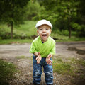Amazed or surprised boy outside little portrait Royalty Free Stock Image