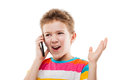 Amazed and surprised child boy talking mobile phone or smartphon hand holding smartphone white isolated Royalty Free Stock Photos