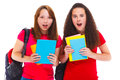 Amazed teenage girls with books in hands Stock Photo
