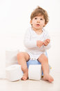 Amazed toddler boy on potty looking up and thinking Stock Images